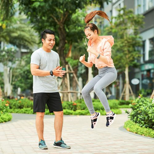 pretty-woman-exercising-with-trainer-CWVFF2R